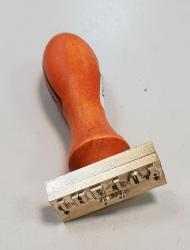 Клеймо на деревянной ручке